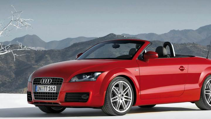 Audi TT Roadster Near Mountains In Red